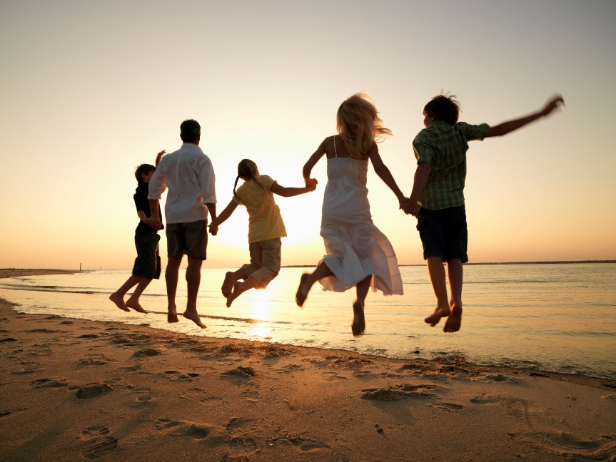 Family Jumping at the Beach